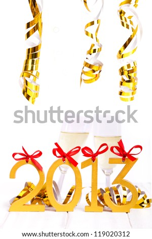 Happy New Year celebration background, Cheers! Two champagne glasses,  2013 numbers from wood - stock photo