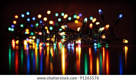 Happy New Year colored lights reflecting on the floor - stock photo