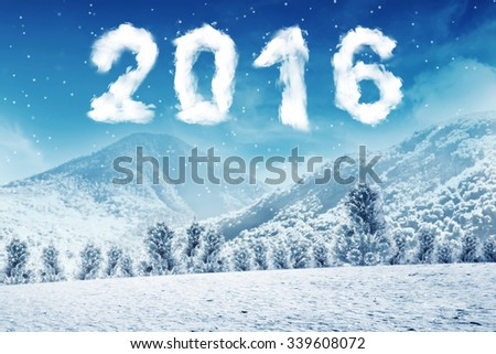 Happy new year concept. 2016 number cloud shape on the snow mountain - stock photo