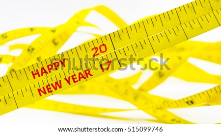 happy new year 2017 concept, on yellow tape  blurred background