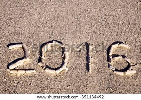 Happy new year 2016 creative on beach - stock photo