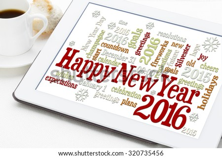 Happy New Year 2016 greetings - word cloud on a digital tablet with a cup of coffee - stock photo