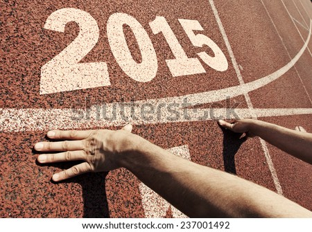 happy new year 2015 - hands on starting line - stock photo