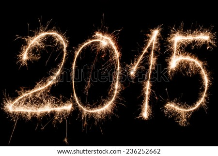 Happy New Year 2015- inscription made sparklers. - stock photo