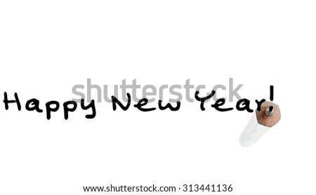 Happy New Year inscription with a tip of a graphite pencil on a white background