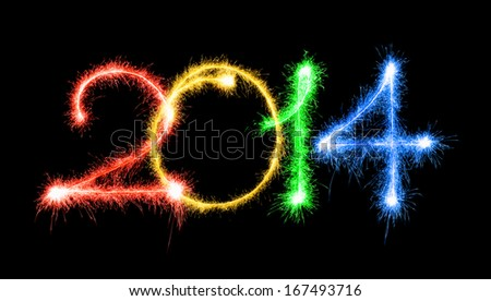 Happy New Year - 2014 made a sparkler different colors on a black background - stock photo