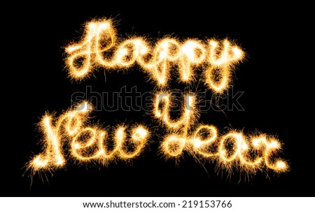 Happy New Year made of sparkles on black background - stock photo