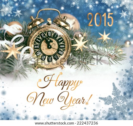Happy New Year 2015! Old alarm clock set to five to twelve decorated for New Year - stock photo