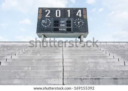 Happy new year 2014 on old score board - stock photo