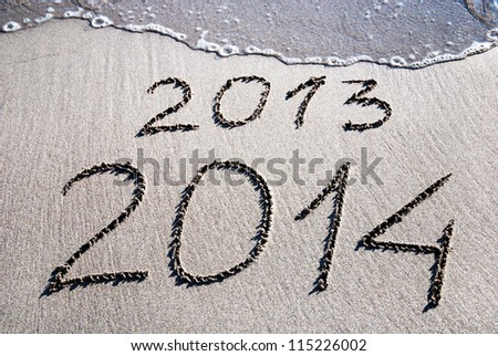 Happy New Year 2014 replace 2013 concept on the sea beach - stock photo