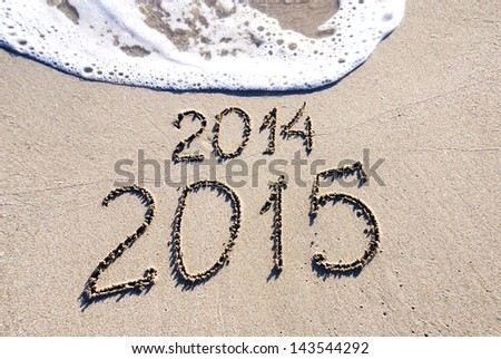 Happy New Year 2015 replace 2014 concept on the sea beach - stock photo