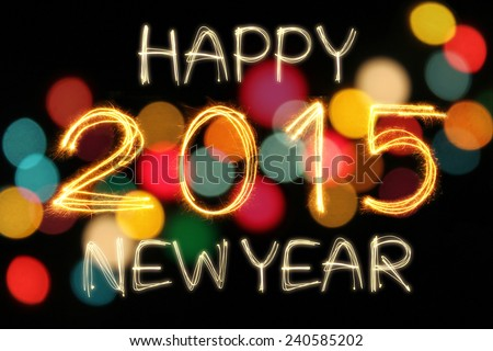 Happy New Year 2015 sparkle firework writing with unfocused dirty colorful light blur bokeh background - stock photo