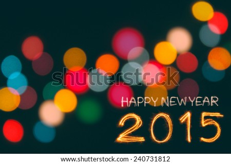 Happy New Year 2015 sparkle firework writing with unfocused dirty colorful light blur bokeh background in Vintage tone - stock photo