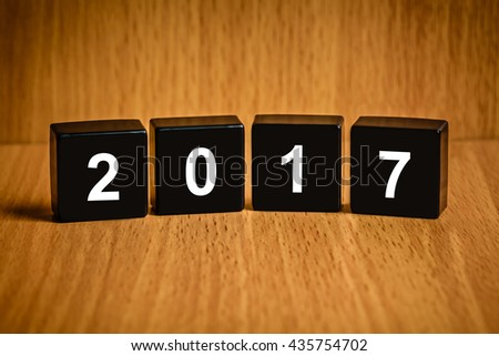 Happy new year 2017 text on black block