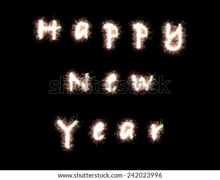 Happy New Year. The words are written with fireworks sparklers on black background - stock photo