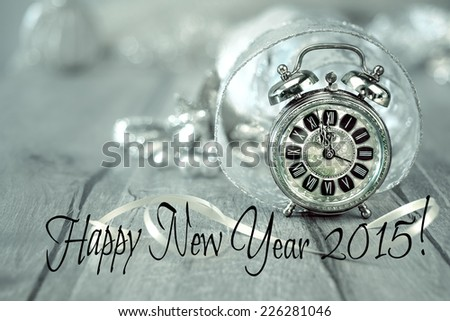 Happy New Year 2015! Wintage clock set on five to twelve with golden decorations - stock photo