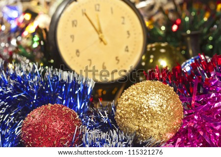 Happy New Year with Christmas toys and old clock