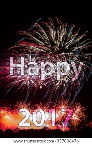 Happy New Year 2017 with colorful sparklers. The words Happy 2017 are integrated into the fireworks with black background - stock photo