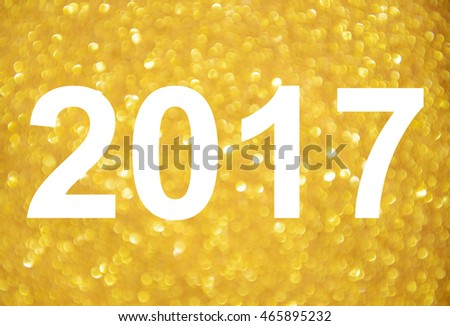 Happy new year 2017 with golden glitter background