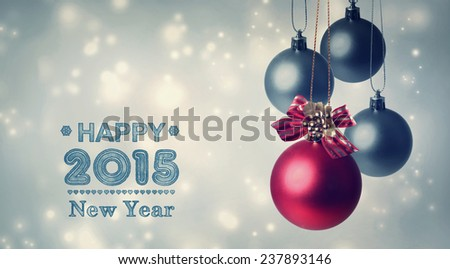 Happy New Year 2015 with Red and gray baubles in snowy night - stock photo