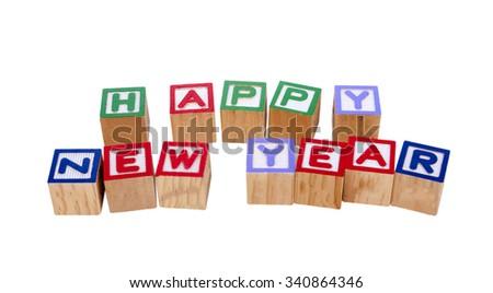 happy new year wood block on isolated background - stock photo