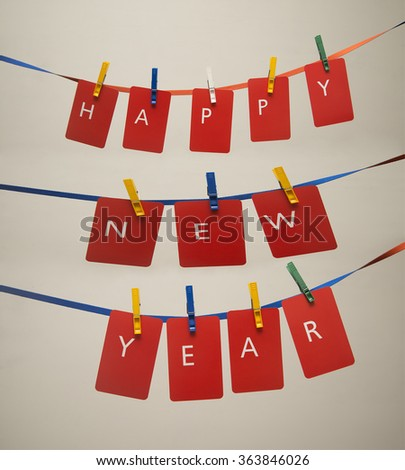happy new year 2017 word hanging on the Notes paper cards in clothes pegs on rope - stock photo