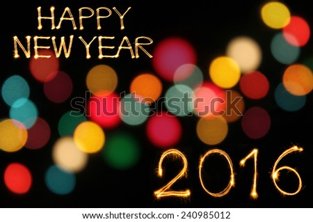 Happy new year 2016 writing sparkles firework with dirty defocused light blur bokeh background - stock photo