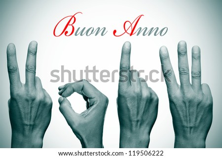happy new year written in italian, with hands forming number 2013 - stock photo