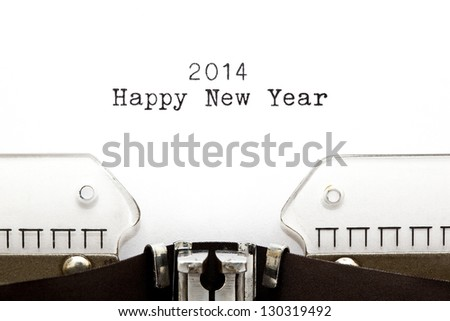 Happy New Year 2014 written on an old typewriter. - stock photo