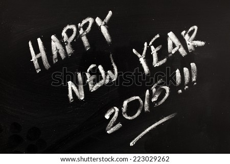 Happy New year 2015 written on blackboard. - stock photo