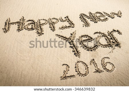 Happy new year 2016 written on sand - stock photo