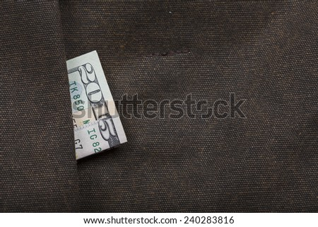 Happy New Year 2015 written with dollar banknotes on pocket of brown leather bag - stock photo