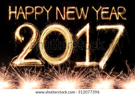 Happy new year 2017 written with Sparkle firework - stock photo