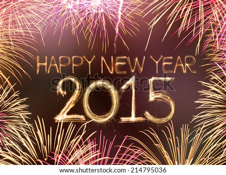 Happy new year 2015 written with Sparkling figures and fireworks - stock photo