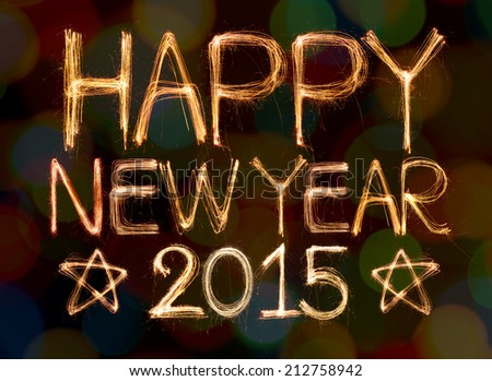 Happy new year 2015 written with Sparkling figures on bokeh background - stock photo