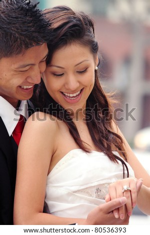 Happy Newlywed Couple on Their Wedding Day - stock photo