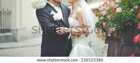 Happy newlywed couple together downtown.  - stock photo