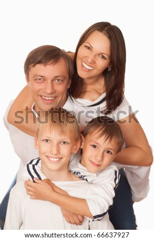 happy nice family of four on a light background
