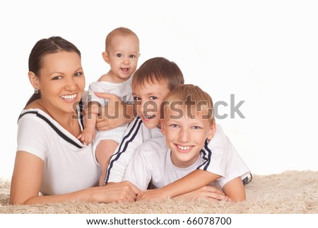 happy nice family of four on a white background
