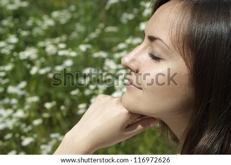 happy nice girl in a summer park - stock photo