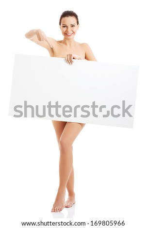 Happy nude woman holding copy space. Isolated on white. - stock photo