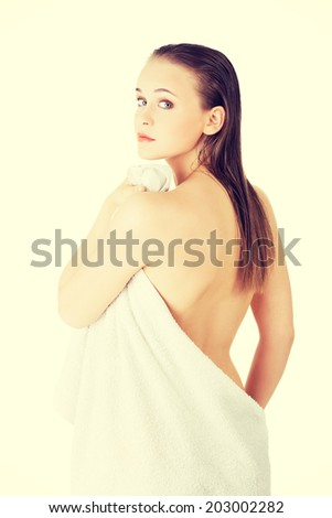 Happy nude woman with perfect body posing with white towel. - stock photo