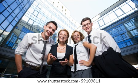 Happy office workers stay across building - stock photo