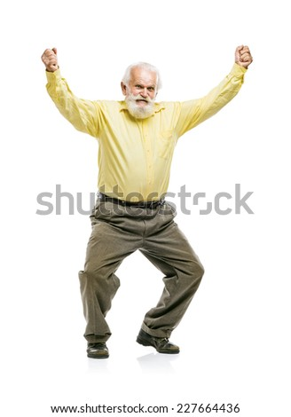 Happy old active bearded man jumping isolated on white background - stock photo