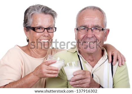 Happy old couple drinking milk, Over white background