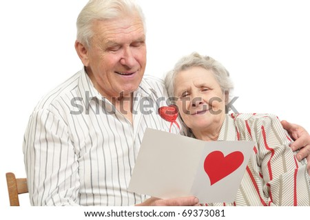 happy old couple with post-card on white background - stock photo