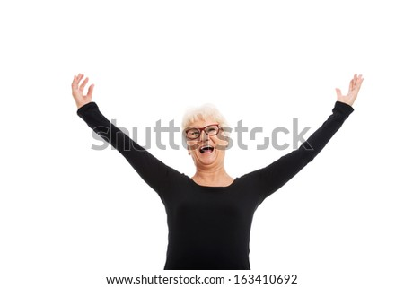 Happy old lady with raised hands. Isolated on white.  - stock photo