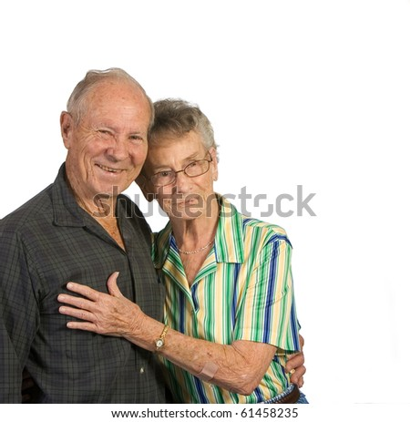 Happy old man and woman hugging. Shot against a white background. - stock photo
