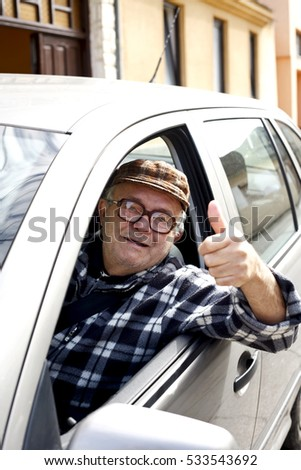 happy old man driving a car