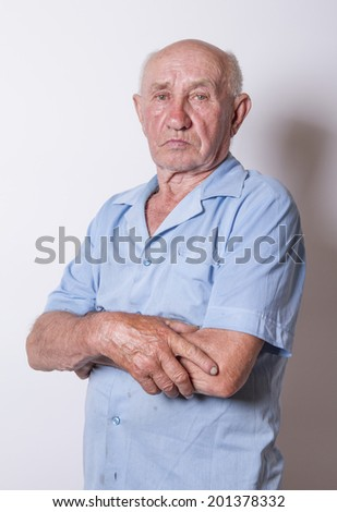 Happy old Man With Arms Crossed - stock photo